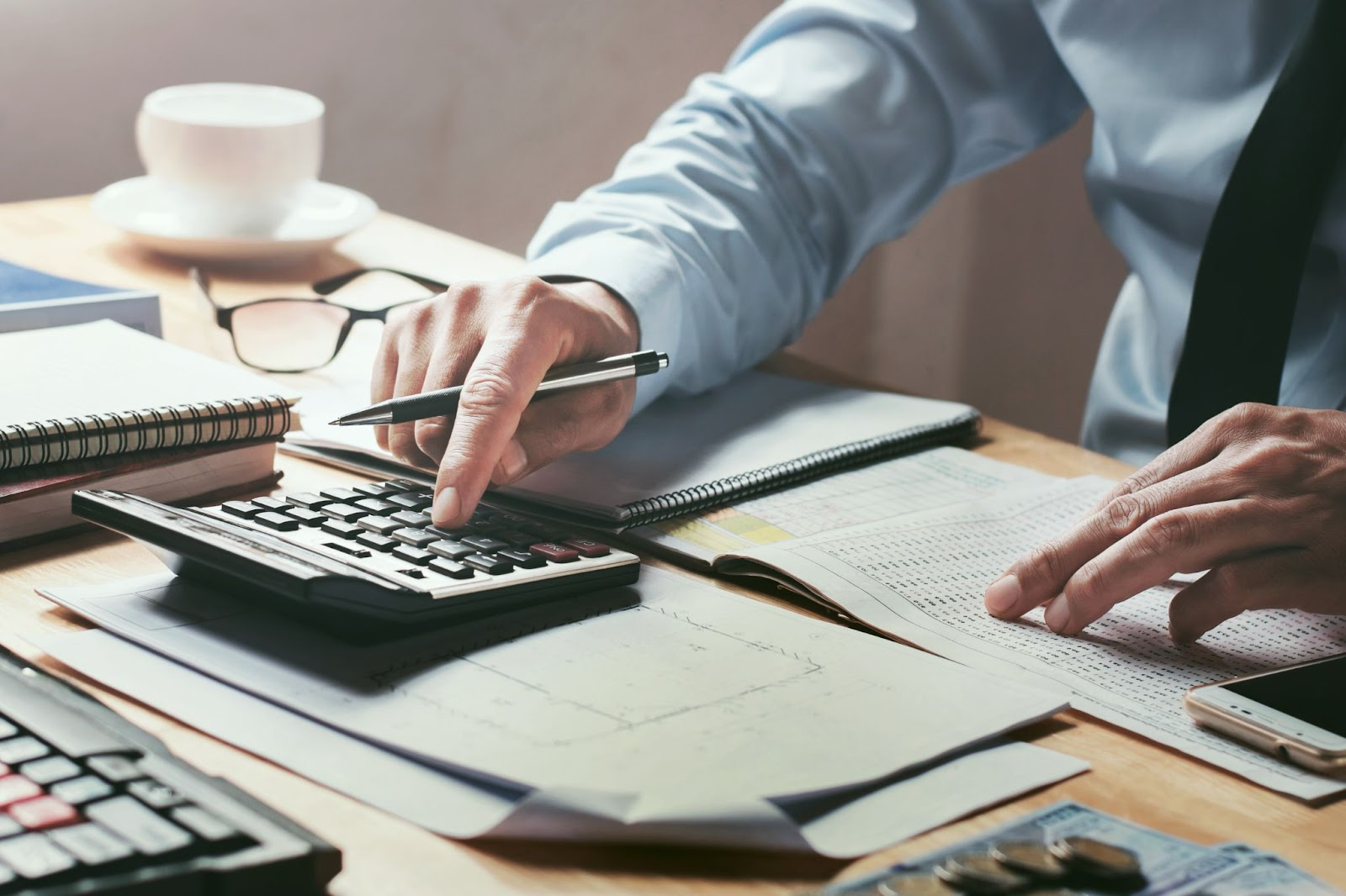 what are qualified dividends: Businessman using a calculator