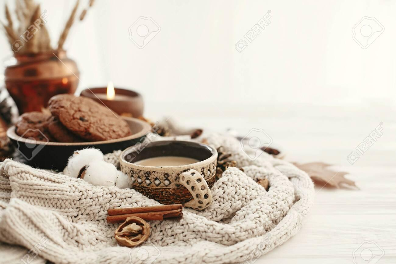 D:\Work\129110851-hygge-lifestyle-cozy-autumn-mood-coffee-cup-chocolate-cookies-candle-and-fall-leaves-cotton-cinnamon.jpg