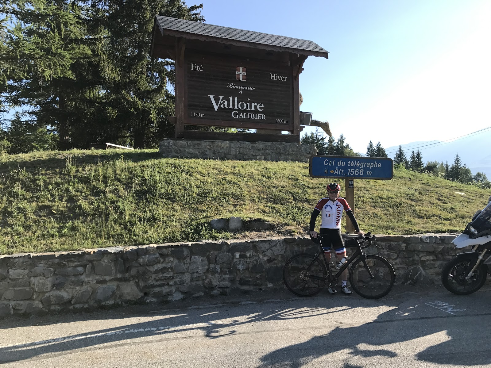 Cycling Col du Telegraphe and Col du Galibier - John Johnson and PJAMM with bike at Col du Telegraphe.