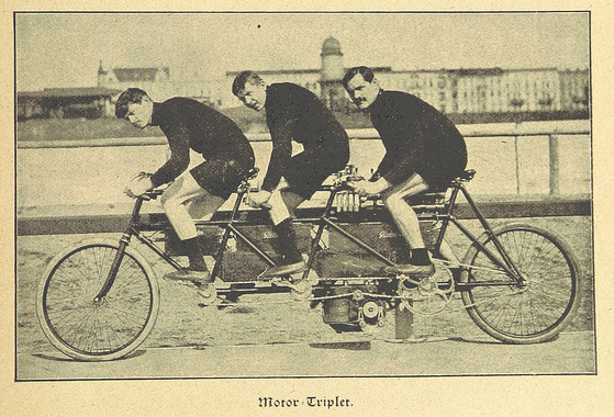 photo of 3 men on a triple bicycle