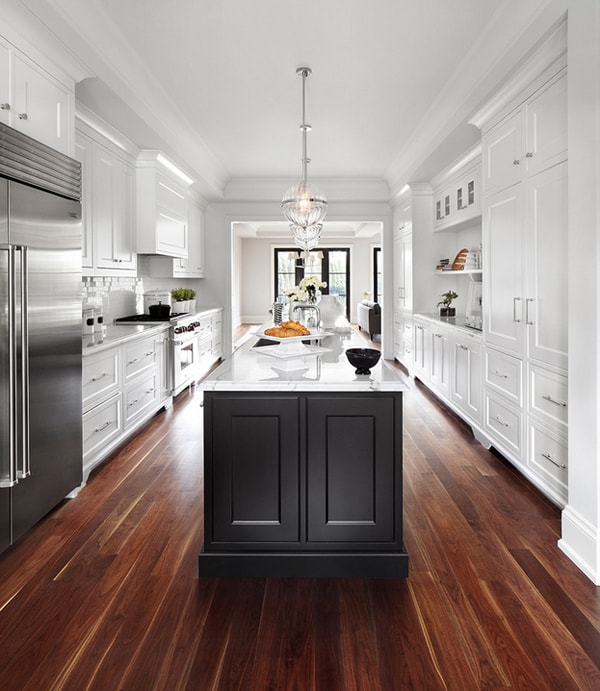 large galley kitchen remodel with dark wood floors, white shaker cabinets, stainless steel appliances and a large black and white center island