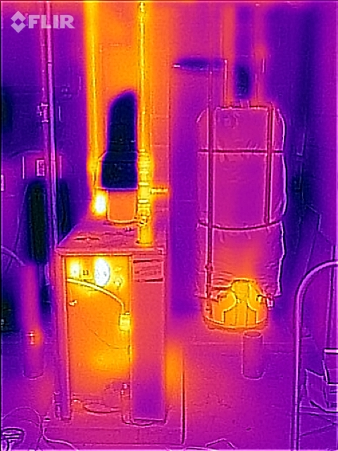 Infrared picture, left to right water softener tank, boiler, hot water heater.