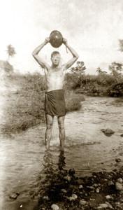 Walt showering in New Guinea, 1943 or 1944
