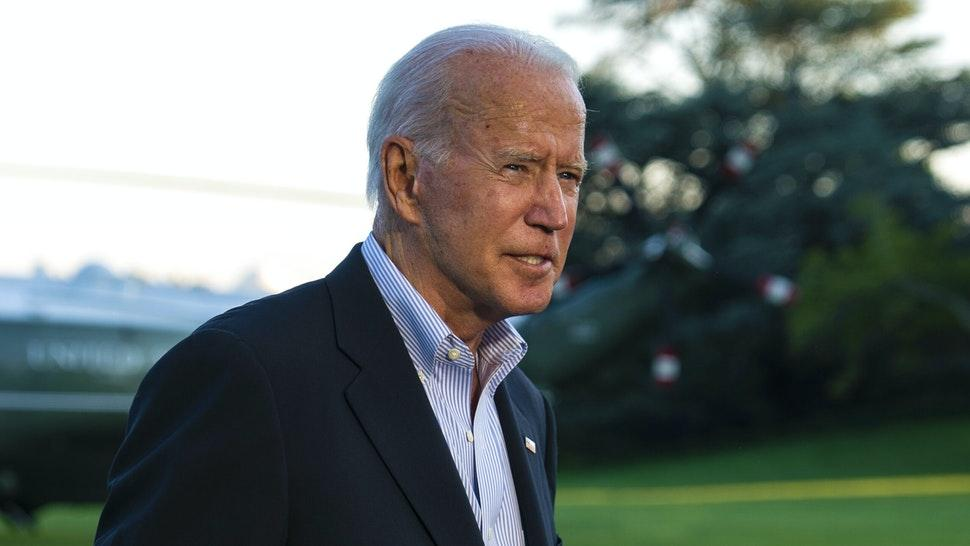 U.S. President Joe Biden speaks with members of the media on the South Lawn of the White House after arriving on Marine One in Washington, D.C., U.S., on Tuesday, Sept. 7, 2021. Biden redoubled his push for a $550 billion public works bill today, using flood-stricken areas of New York and New Jersey as a backdrop to underscore the threat climate change poses to critical services.