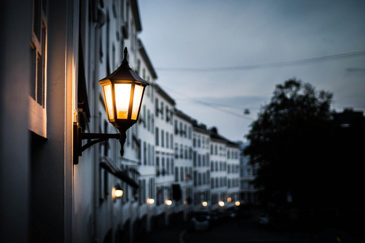Outdoor wall sconce fixed on a building