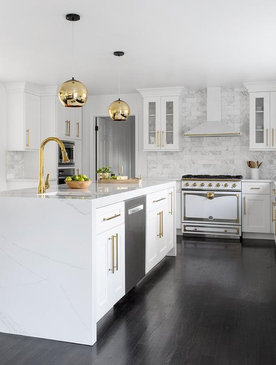 white shaker kitchen with brass globe lights
