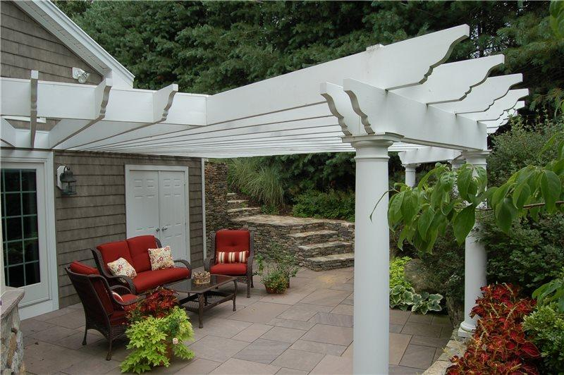 An attached pergola over the patio on your backyard