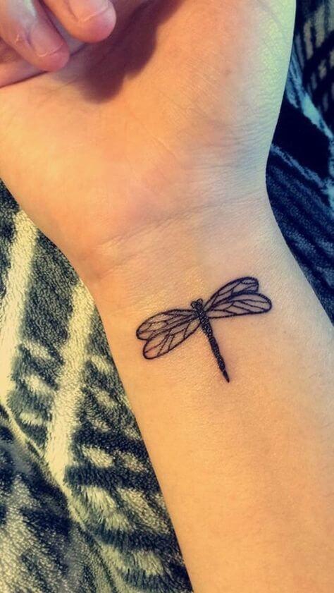 minimalistic dragonfly tattoo on wrist