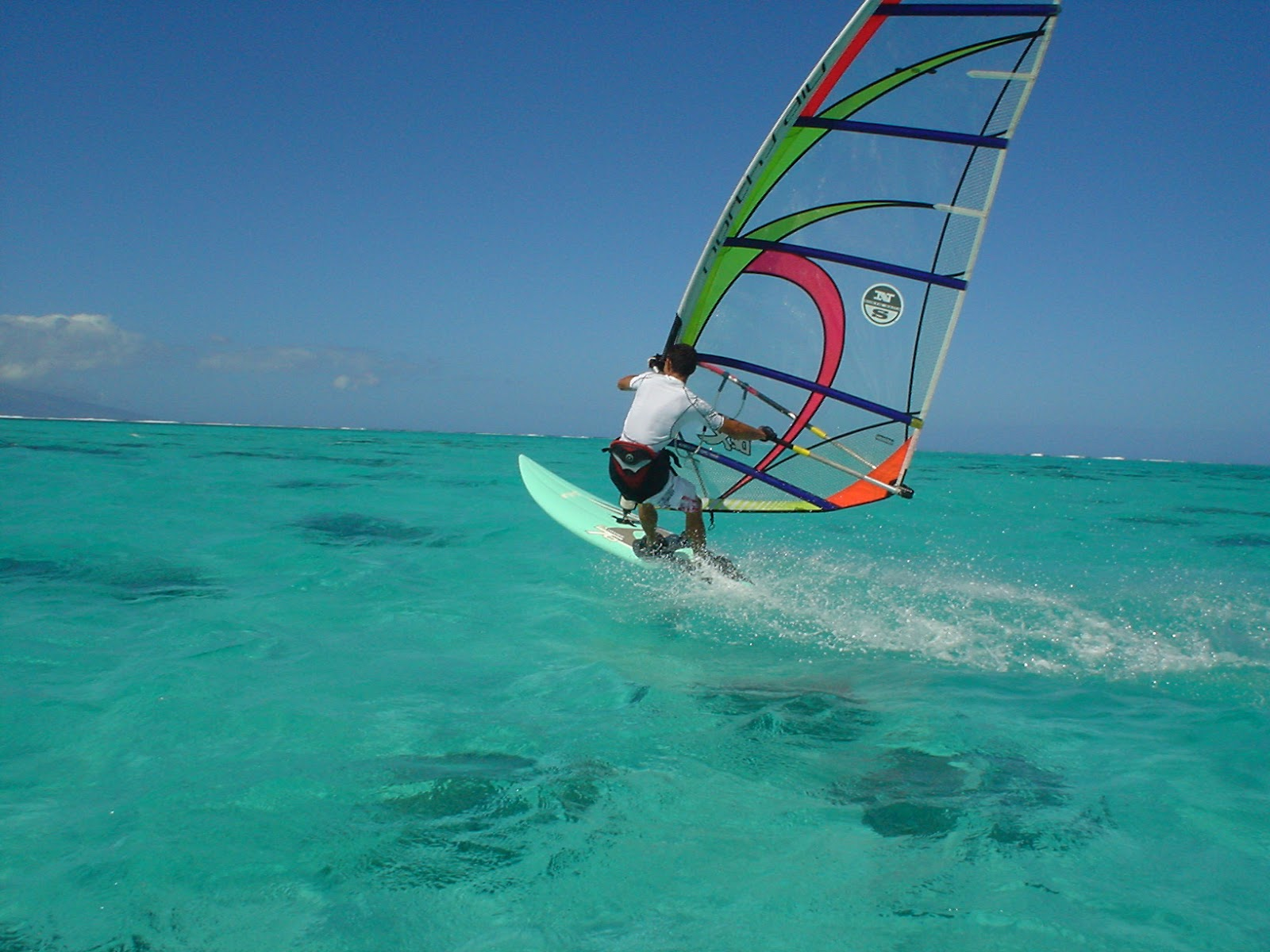 A windsurfer on calm water
