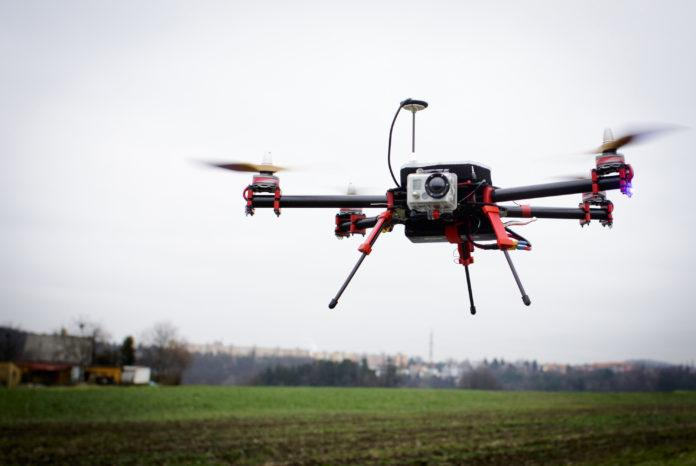 A drone hovering over a field.