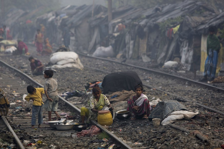 KOLKATA, INDIA - NOVEMBER 12:  Slum dwellers live by a railroad track Kolkata, India. India's slum population is projected to rise to 93.06 million by 2011, or 7.75 percent of the total population, according to a report of an expert committee set up by the housing and urban poverty alleviation ministry.  (Photo by Kuni Takahashi/Getty Images)