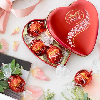 A chocolate gift hamper for your first anniversary; Clintons Lindor Heart Tin 50g