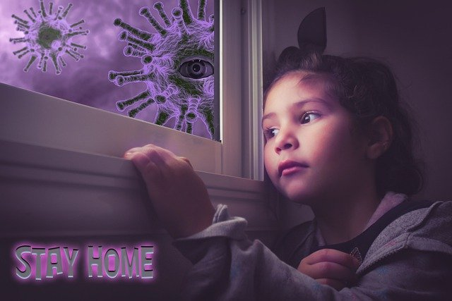 a kid looking outside the window seeing novel COVID-19 virus during a lockdown in US