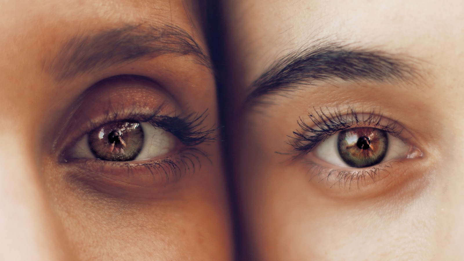 two eyes from two different women stand side by side