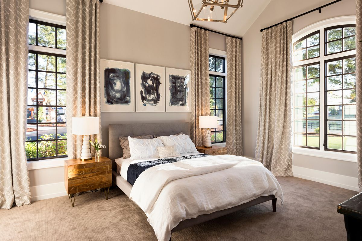 Raised curtains in bedroom.