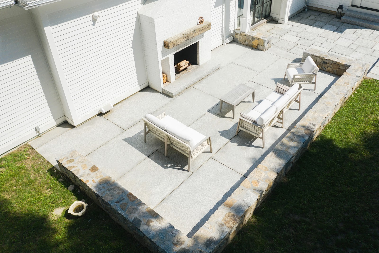 This contemporary patio features large Woodbury Gray granite pavers