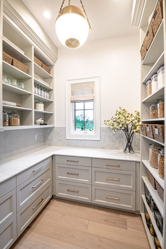 grey shaker cabinets in large walk in pantry, pantry organization ideas diy, wood floors and pendant light