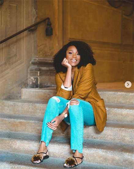 Nigerian influncer Dimma Umeh sitting on steps in jeans and a blazer - Top 25 Social Media Influencers Making Impacts in Nigeria Today