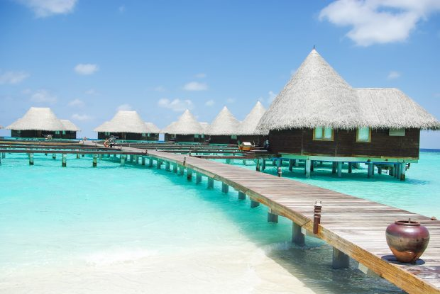 Image of cabins built over clear blue sea - represents that you should learn the truth about budget and acheive all your financial goals in life