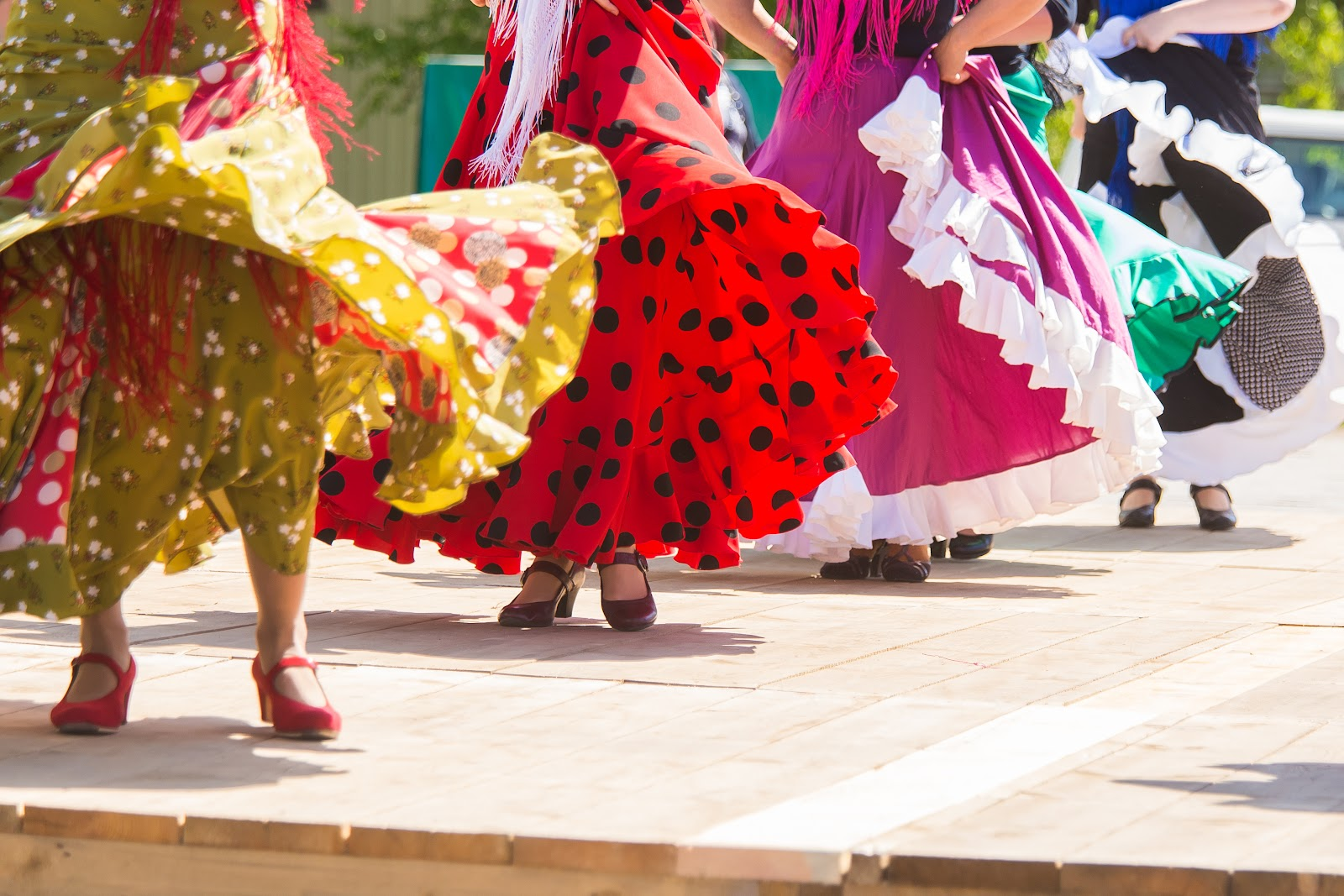 Flamenco dancers dancing with flowy, colorful skirts