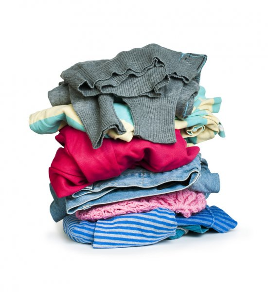 Pile of clothes white isolated — Stock Photo