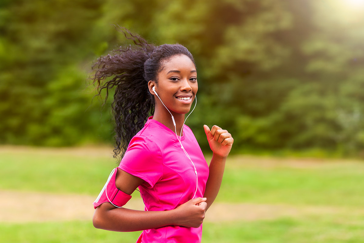 Protein facts: Beautiful woman jogging while wearing earbuds
