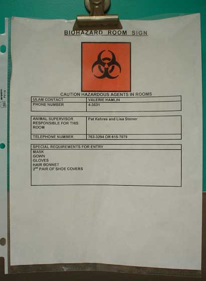 Biohazard room sign with contact personnel information and a list of required personal protective equipment for room entry. (Photo credit: R. Ilkhani-Pour and D. Molnar).