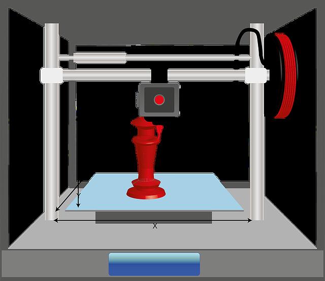 Obraz zawierający komputer, zabawka, stół  Opis wygenerowany automatycznie