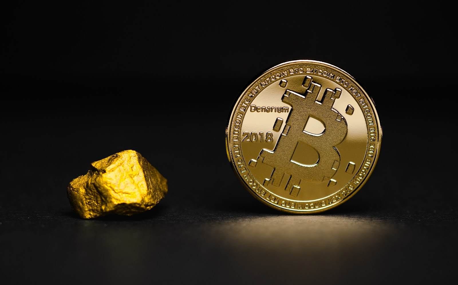 a photo of Bitcoin and gold