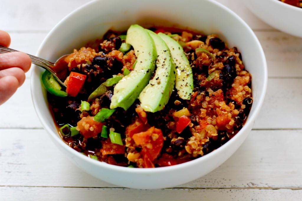 Top, side View of bowl of Black Bean Chili with spoon in it