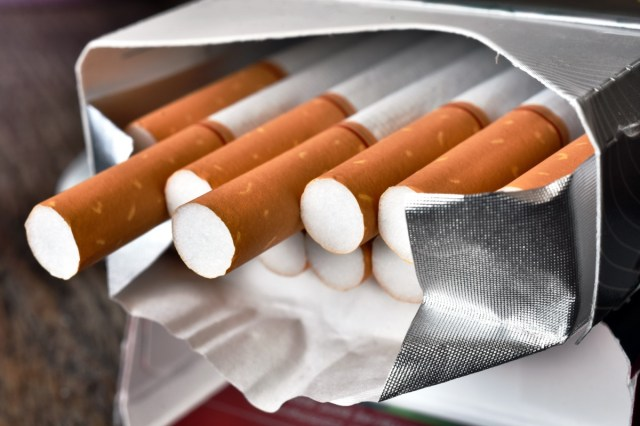 A close up image of an open package of cigarettes.