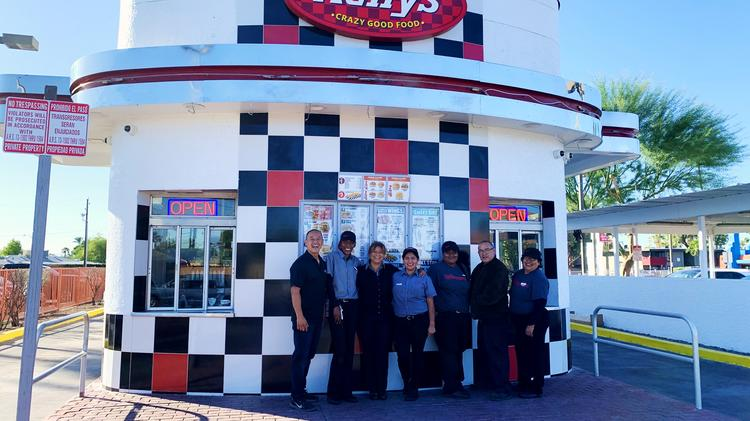 Rally's franchisee Bruce Ong and the staff of the 1345 W. Camelback Road Rally's in October 2019 soon after the location reopened.