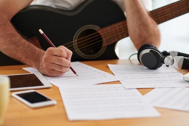 guitarist writing music