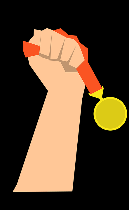 Hand holding a medal