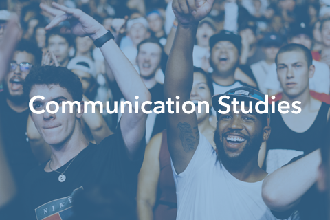 """An image of people at a concert or large event. Bold text is placed over the image. It reads: """"Communication Studies""""."""