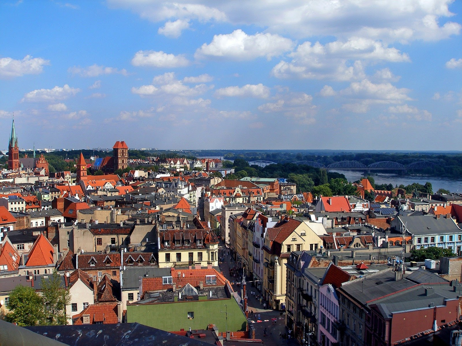 torun old town colorful medieval buildings on a sunny day vistula river in background
