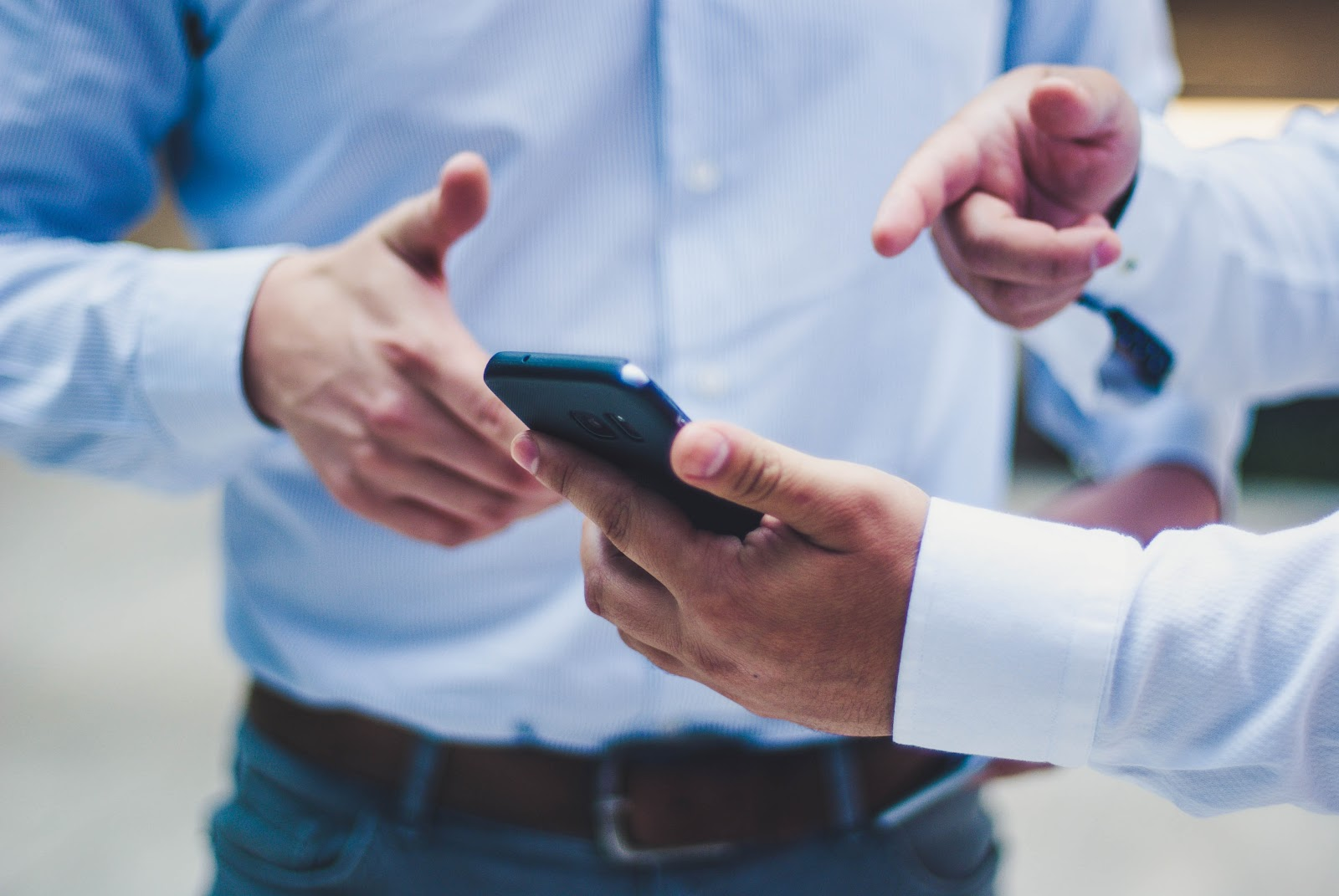 Two people looking at a smartphone