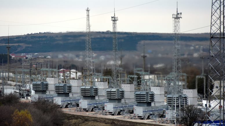 A mobile gas turbine power plant works to provide electricity in Stroganovka village outside Simferopol, Crimea, Sunday, Nov. 22, 2015. Russia's Energy Ministry says nearly 2 million people on the Crimean Peninsula are without electricity after two transmission towers in Ukraine were damaged by explosions. (AP Photo/Alexander Polegenko)