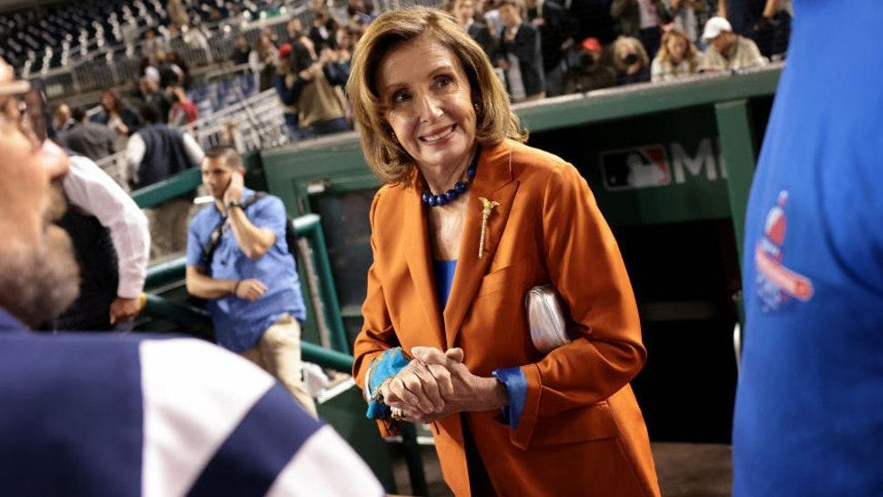 House Speaker Nancy Pelosi (D-CA) congratulates members of the Democratic team following the Congressional baseball game at Nationals Park September 29, 2021 in Washington, DC.