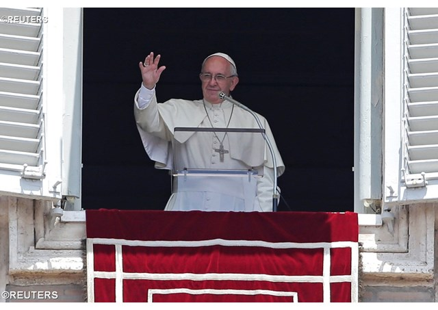 Pope Francis greets pilgrims from around the world during Sunday's Angelus address. - REUTERS