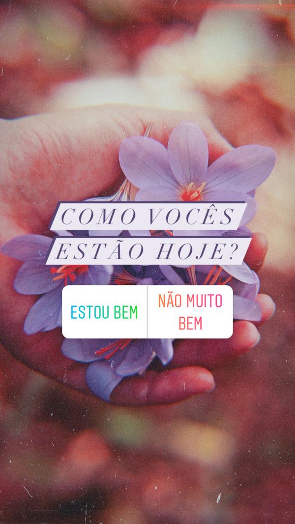 """foto de uma mão segurando flores com os dizeres """"Como vocês estão hoje?"""" e a enquete """"estou bem"""" e """"não muito bem"""""""