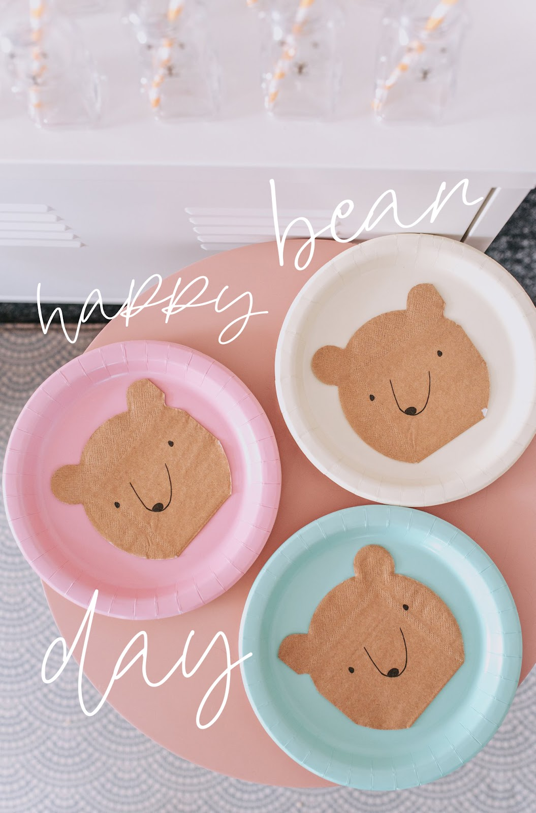 bear and rose gold themed birthday party Meri Meri bear napkins on pastel plates