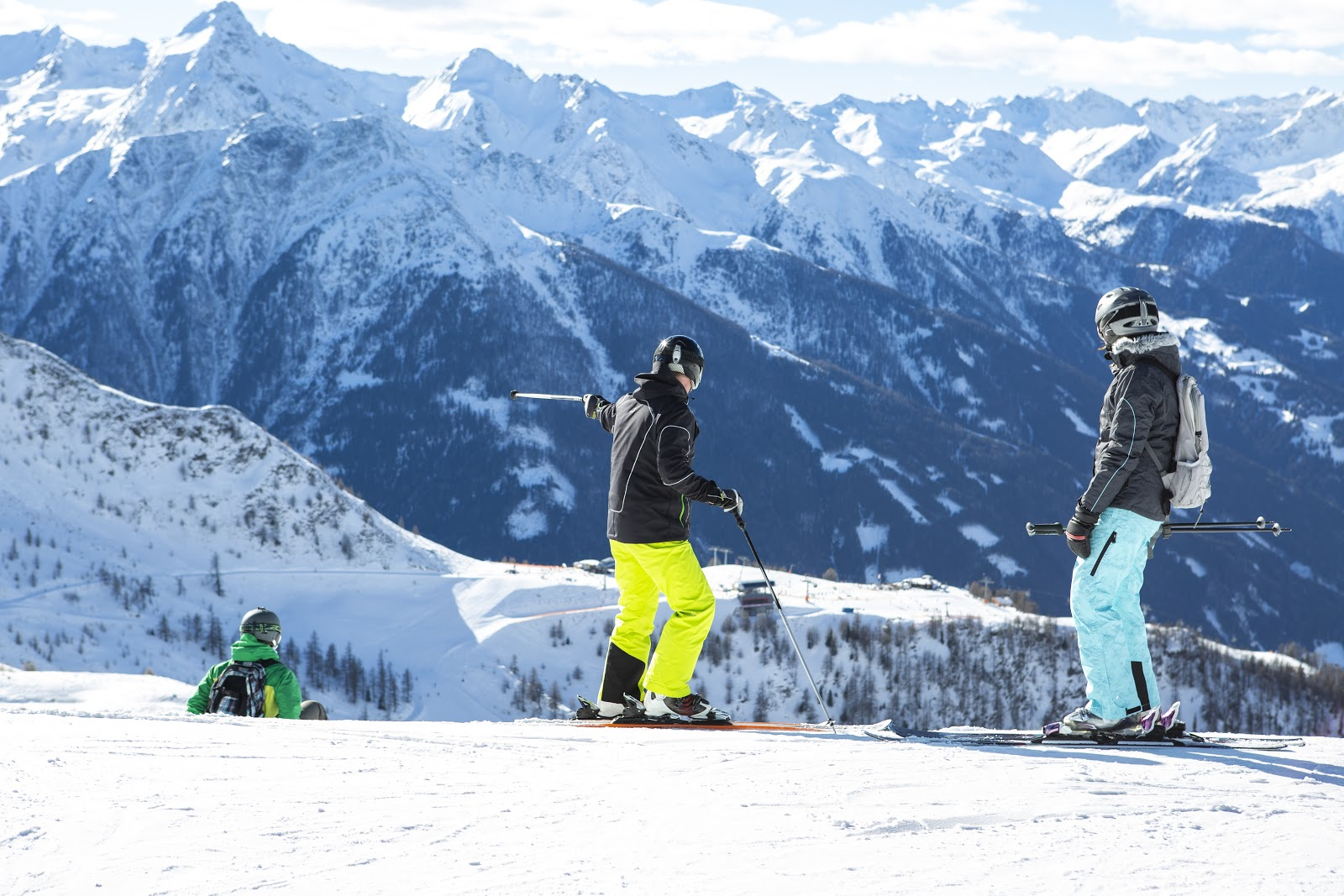 People on a high slope skiing