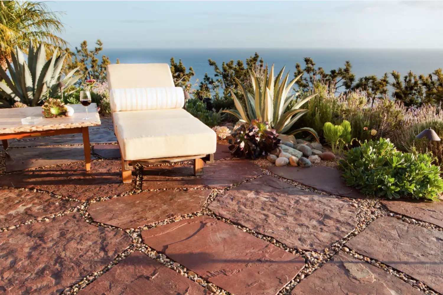 ocean view with lounge char and plants