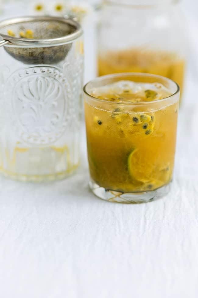 A glass of Passion fruit caipirinha served in a rocks glass
