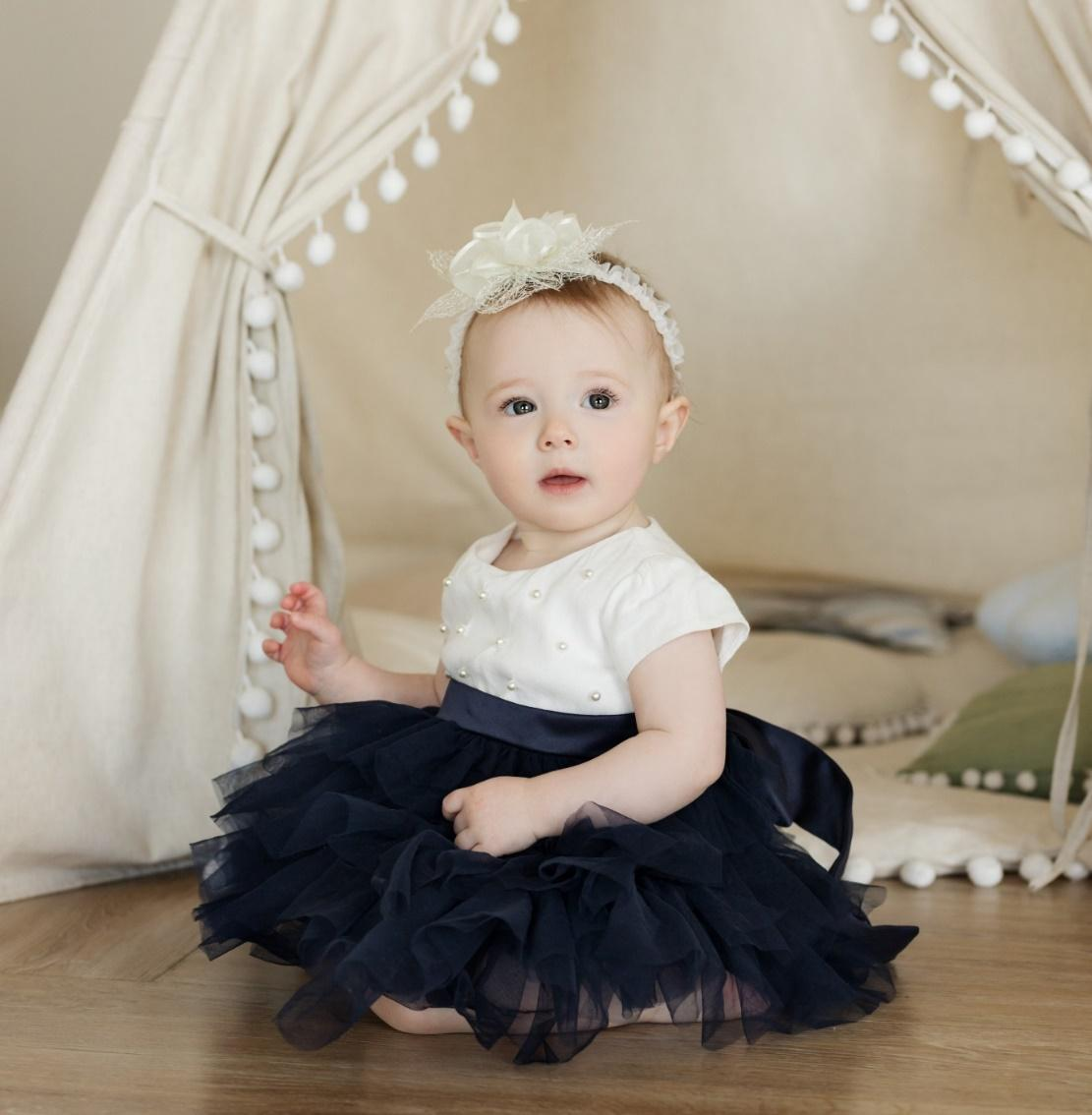 A royal like baby posing for the camera