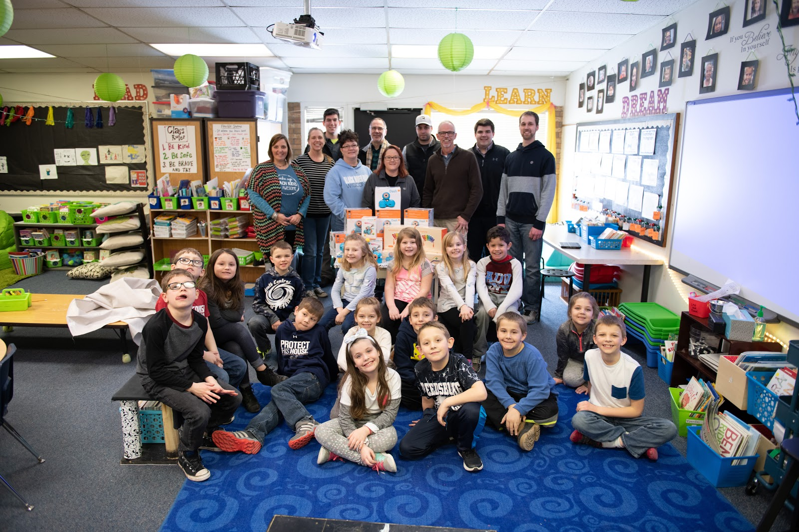 Columbia Vehicle Group team members donate STEM robots to elementary school classroom