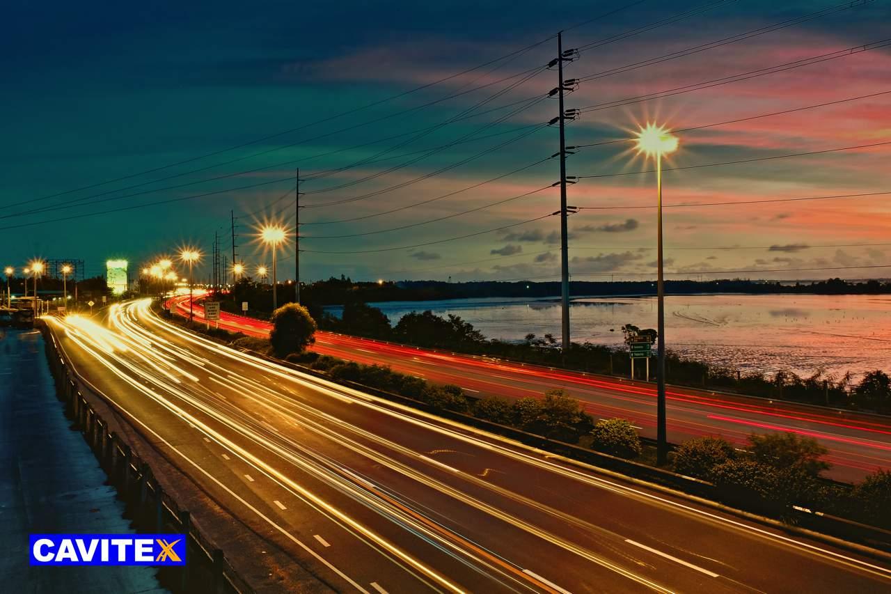 Car lights at night along infrastructure developments