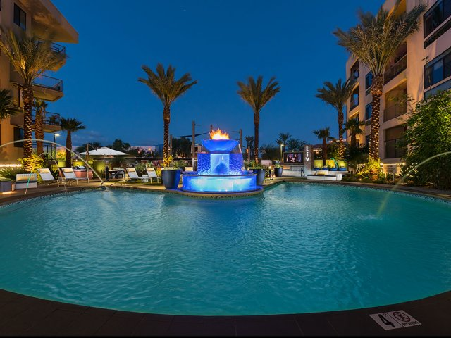 Liv North Scottsdale swimming pool lit up at night time.