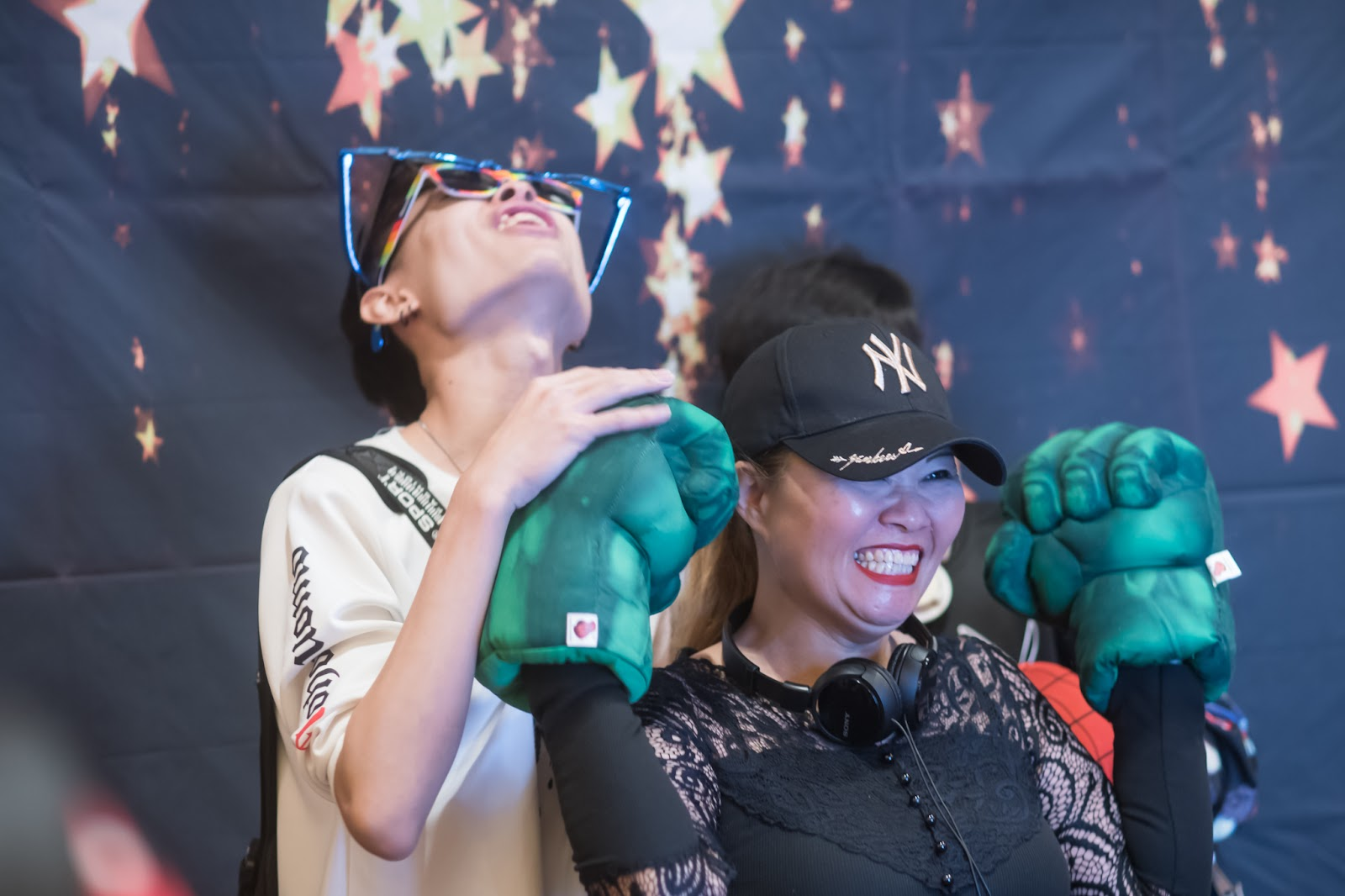 mother and son enjoying photo booth props